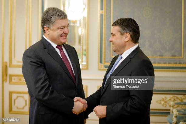 German Foreign Minister and Vice Chancellor Sigmar Gabriel shakes hands with President of Ukraine Petro Poroschenko on March 02 2017 in Kiev Ukraine...