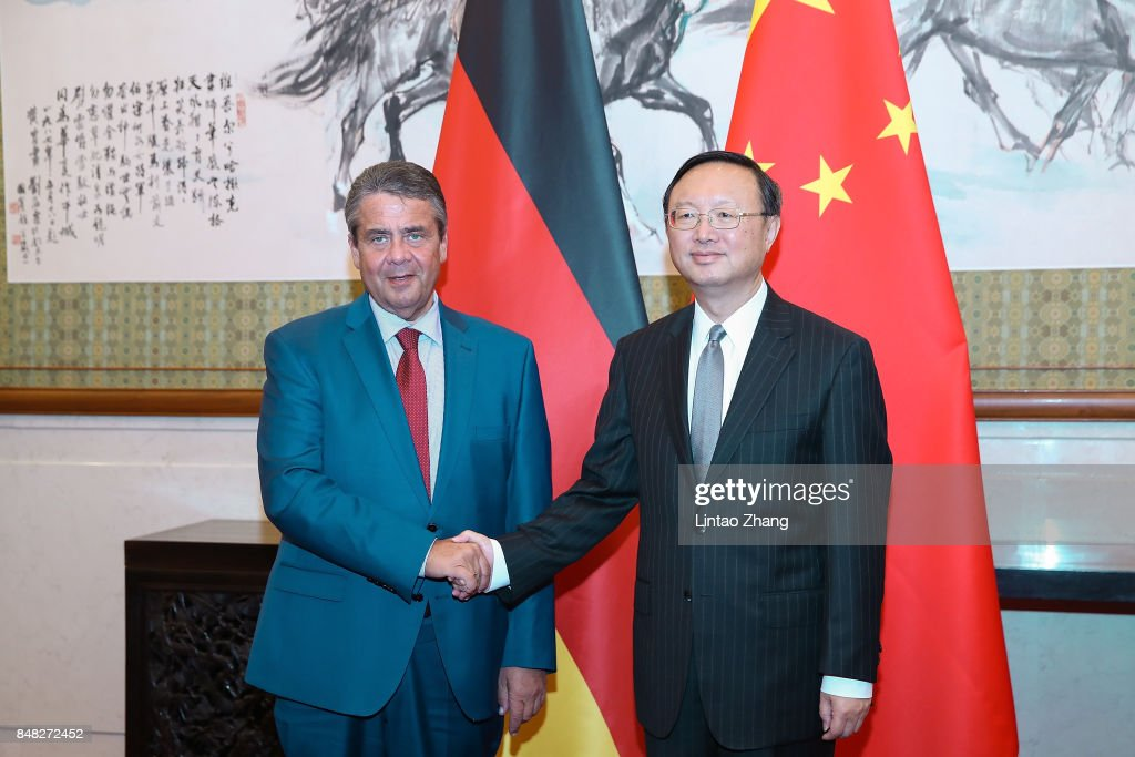 German Foreign Minister and Vice Chancellor Sigmar Gabriel (L) shakes hands with Chinese State Councilor Yang Jiechi before their meeting at Diaoyutai State Guesthouse at on September 17, 2017 in Beijing, China.