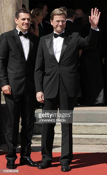 German Foreign Minister and vicechancellor Guido Westerwelle and his partner Michael Mronz poses for photographers at the 'Festspielhaus' ahead of...