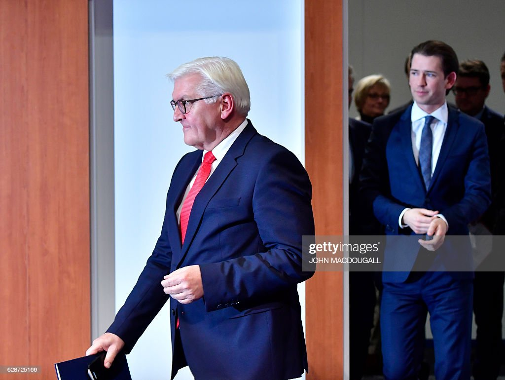 German Foreign Minister Frank-Walter Steinmeier (L) and Austrian Foreign Minister Sebastian Kurz arrive for a press conference after closing session of the foreign ministers' meeting of the Organisation for Security and Cooperation in Europe (OSCE) in Hamburg, northern Germany, on December 9, 2016. / AFP / John MACDOUGALL