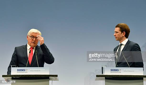 German Foreign Minister FrankWalter Steinmeier and Austrian Foreign Minister Sebastian Kurz attend a press conference after closing session of the...