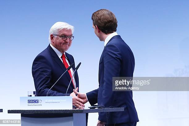 German Foreign Minister FrankWalter Steinmeier and Austrian Foreign Minister Sebastian Kurz shake hands after a press conference during the OSCE...