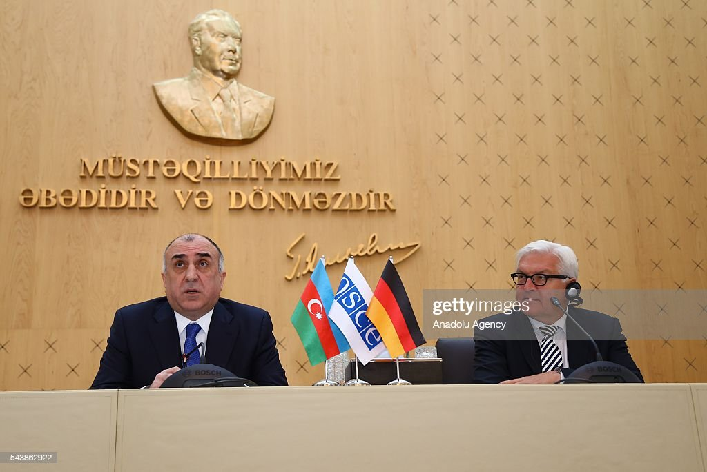 German Foreign Minister Frank-Walter Steinmeier (R) and Azerbaijan's Foreign Minister Elmar Memmedyarov (L) hold a joint press conference after their meeting in Baku, Azerbaijan on June 30, 2016.