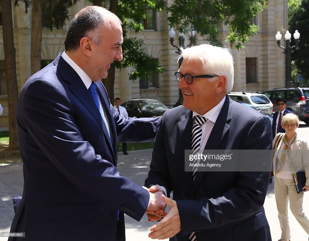 German Foreign Minister Frank-Walter Steinmeier (R) and Azerbaijan's Foreign Minister Elmar Memmedyarov (L) shake hands during their meeting in Baku, Azerbaijan on June 30, 2016.