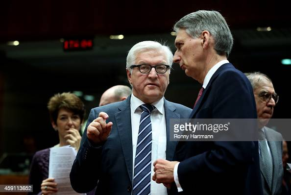 German Foreign Minister FrankWalter Steinmeier and British foreign Minister Philip Hammond talk to each other during a Foreign Affairs Council...