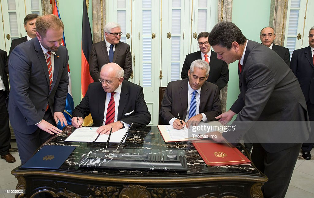 German Foreign Minister <a gi-track='captionPersonalityLinkClicked' href=/galleries/search?phrase=Frank-Walter+Steinmeier&family=editorial&specificpeople=603500 ng-click='$event.stopPropagation()'>Frank-Walter Steinmeier</a> (L) and Cubas Foreign Minister Bruno Rodriguez Parrilla (R) attend the signing of a declaration of collaborations between Cuba and Germany which is signed by German Ambassador Peter Rudolf Scholz (L) and the head of the department for bilateral relationships in Cubas Foreign Office, Gerardo Penalver Portal (R) on July 16, 2015 in Havana, Cuba.