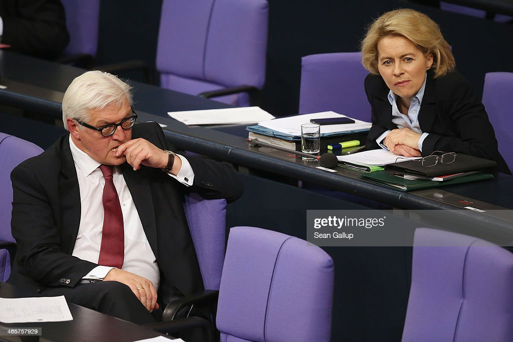 German Foreign Minister <a gi-track='captionPersonalityLinkClicked' href=/galleries/search?phrase=Frank-Walter+Steinmeier&family=editorial&specificpeople=603500 ng-click='$event.stopPropagation()'>Frank-Walter Steinmeier</a> (L) and Defense Minister <a gi-track='captionPersonalityLinkClicked' href=/galleries/search?phrase=Ursula+von+der+Leyen&family=editorial&specificpeople=4249207 ng-click='$event.stopPropagation()'>Ursula von der Leyen</a> attend debates at the Bundestag following a government declaration given by German Chancellor Angela Merkel, in which she outlined the policy priorities of the new German coalition government of Christian Democrats and Social Democrats, on January 29, 2104 in Berlin, Germany. The new government was sworn in in December and has a strong majority in the Bundestag to push through legislation.