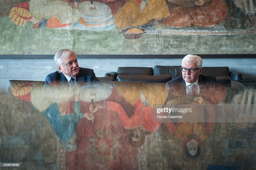 German Foreign Minister Frank-Walter Steinmeier (R) and Edward Nalbandian (L), Foreign Minister of Armenia, sit in the hall of the airport on June 30, 2016 in Yerewan, Armenia. He visits the south caucasian countries Armenia, Azerbaijan and Georgia for political conversations.
