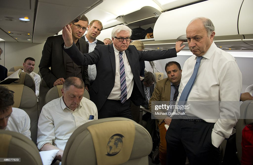 German Foreign Minister <a gi-track='captionPersonalityLinkClicked' href=/galleries/search?phrase=Frank-Walter+Steinmeier&family=editorial&specificpeople=603500 ng-click='$event.stopPropagation()'>Frank-Walter Steinmeier</a> (C) and French Foreign Minister <a gi-track='captionPersonalityLinkClicked' href=/galleries/search?phrase=Laurent+Fabius&family=editorial&specificpeople=540660 ng-click='$event.stopPropagation()'>Laurent Fabius</a> (R) on board a German Air Force plane during the flight from Chisinau in Moldova to Tiblisi in Georgia on April 23, 2014 in Chisinau, Moldavia. German foreign minister <a gi-track='captionPersonalityLinkClicked' href=/galleries/search?phrase=Frank-Walter+Steinmeier&family=editorial&specificpeople=603500 ng-click='$event.stopPropagation()'>Frank-Walter Steinmeier</a> and his French counterpart <a gi-track='captionPersonalityLinkClicked' href=/galleries/search?phrase=Laurent+Fabius&family=editorial&specificpeople=540660 ng-click='$event.stopPropagation()'>Laurent Fabius</a> are traveling to Moldova and Georgia, former Soviet Republics, as well as Tunisia and France to strengthen the relationships between the countries as tensions continue to rise over Russia's intentions in Ukraine.