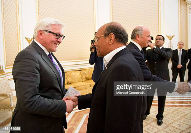 German Foreign Minister FrankWalter Steinmeier and French Foreign Minister Laurent Fabius meet Tunisian President Moncef Mazouki on April 24 2014 in...