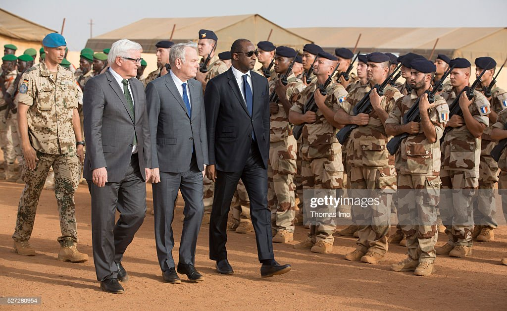 German Foreign Minister Frank-Walter Steinmeier (L) and French Foreign Minister Marc Ayrault (C) visit german and french soldiers in Camp Castor with Minister of Defence of Mali Tieman Hubert Coulibalyon (R) on May 02, 2016 in Gao, Mali. Steinmeier and Ayrault visit Mali and Niger for political conversations.
