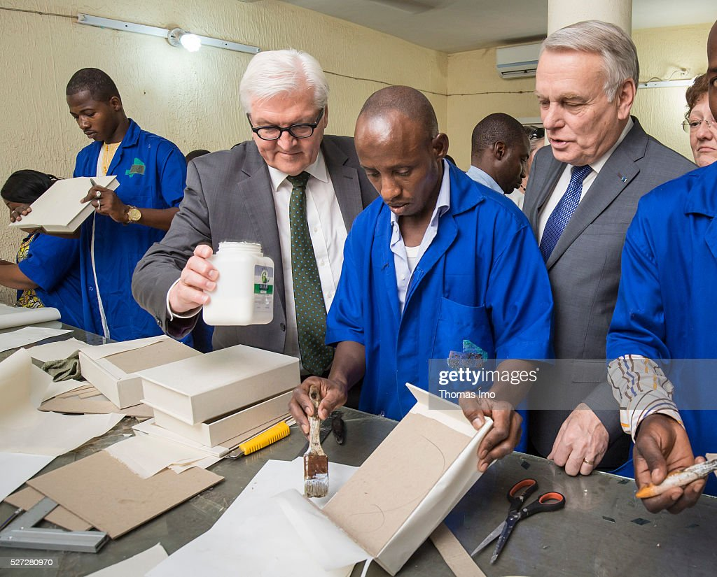 German Foreign Minister Frank-Walter Steinmeier (L) and French Foreign Minister Marc Ayrault (R) look at the historic scriptures of Timbuktu on May 02, 2016 in Bamako, Mali. Steinmeier and Ayrault visit Mali and Niger for political conversations.