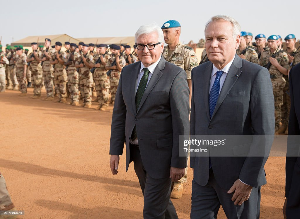 German Foreign Minister Frank-Walter Steinmeier (L) and French Foreign Minister Marc Ayrault (R) visit german and french soldiers in Camp Castor on May 02, 2016 in Gao, Mali. Steinmeier and Ayrault visit Mali and Niger for political conversations.