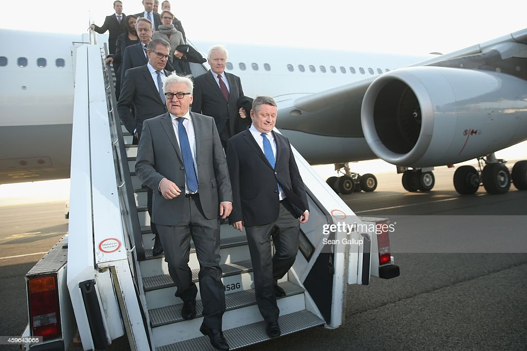 German Foreign Minister <a gi-track='captionPersonalityLinkClicked' href=/galleries/search?phrase=Frank-Walter+Steinmeier&family=editorial&specificpeople=603500 ng-click='$event.stopPropagation()'>Frank-Walter Steinmeier</a> (L) and Health Minister <a gi-track='captionPersonalityLinkClicked' href=/galleries/search?phrase=Hermann+Groehe&family=editorial&specificpeople=6400355 ng-click='$event.stopPropagation()'>Hermann Groehe</a> finish viewing a retrofitted Lufthansa plane equipped with medical isolation facilities for Ebola cases during a media presentation at Tegel airport on November 27, 2014 in Berlin, Germany. The airplane, dubbed the 'Robert Koch' and commisoned by the German government, will serve as a MedEvac option for health workers who are in western Africa participating in the international effort to stem the spread of the deadly Ebola virus. The German Red Cross (DRK), emergency services group (THW) and the Bundeswehr have sent volunteers to treat ebola cases in Liberia and Sierra Leone.