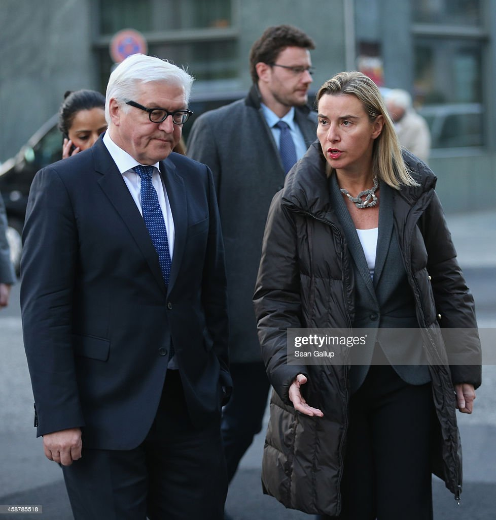 German Foreign Minister FrankWalter Steinmeier and High Representative of the European Union for Foreign Affairs Federica Mogherini walk to an event...