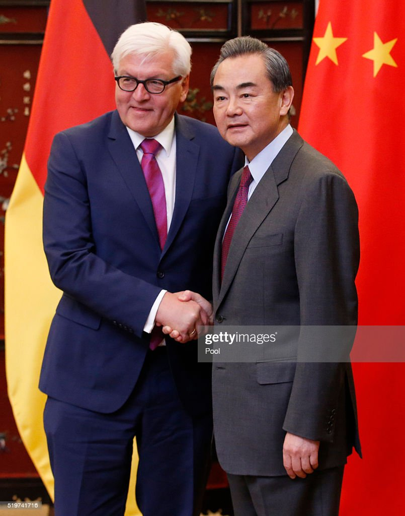 German Foreign Minister <a gi-track='captionPersonalityLinkClicked' href=/galleries/search?phrase=Frank-Walter+Steinmeier&family=editorial&specificpeople=603500 ng-click='$event.stopPropagation()'>Frank-Walter Steinmeier</a> (L) and his Chinese counterpart <a gi-track='captionPersonalityLinkClicked' href=/galleries/search?phrase=Wang+Yi+-+Politician&family=editorial&specificpeople=13620429 ng-click='$event.stopPropagation()'>Wang Yi</a> shake hands as they post for pictures during the second round of the China-Germany strategic dialogue on diplomacy and security in Beijing, China, April 8, 2016.