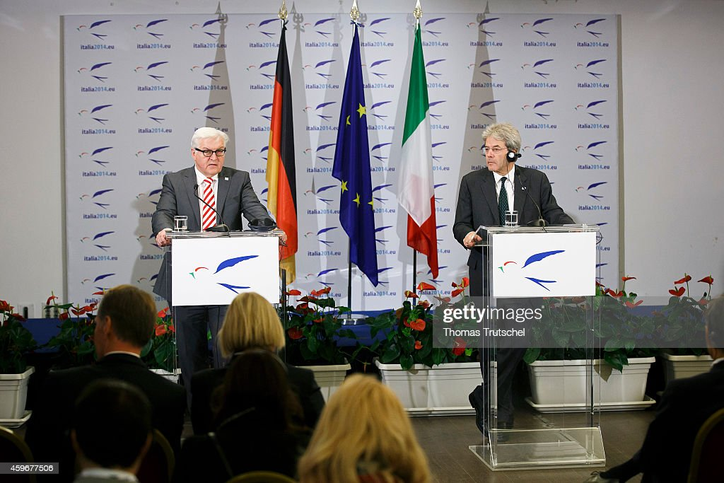 German Foreign Minister Frank-Walter Steinmeier (L) and Italian Foreign Minister Paolo Gentiloni speaks to the media during the Ministerial Conference to launch the Khartoum Process on November 28, 2014 in Rome, Italy.
