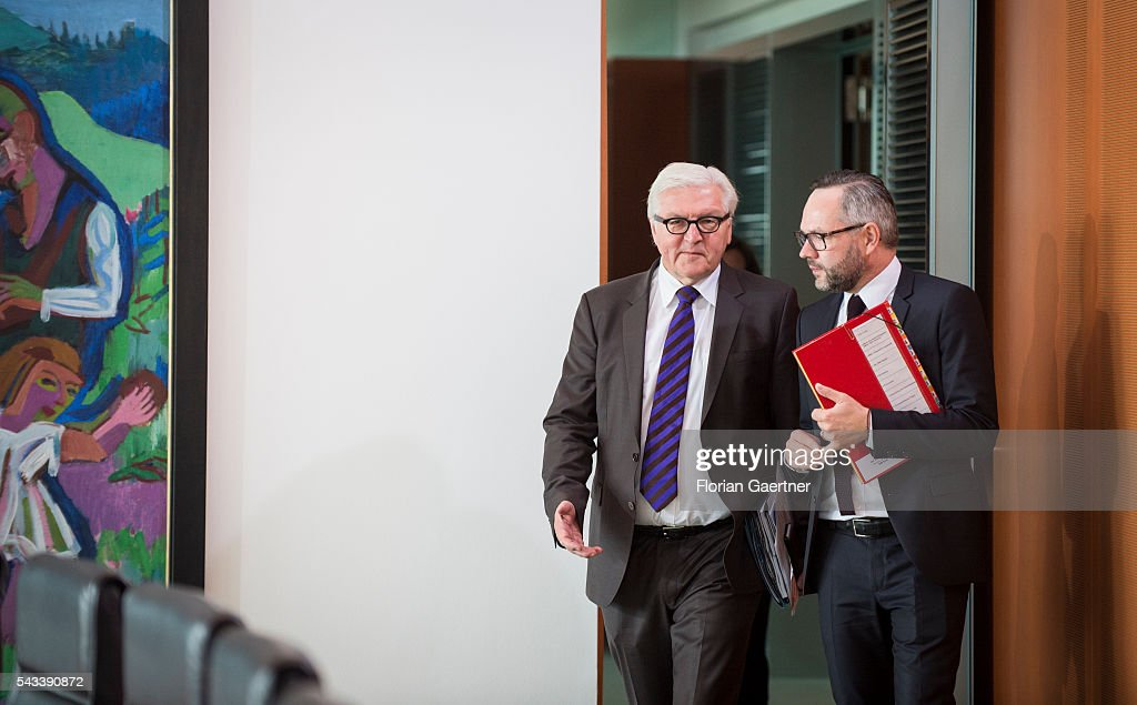 German Foreign Minister Frank-Walter Steinmeier (L) and Michael Roth (R), Minister of State for Europe, arrive for the weekly cabinet meeting at the chancellery (Bundeskanzleramt) on June 28, 2016 in Berlin, Germany.