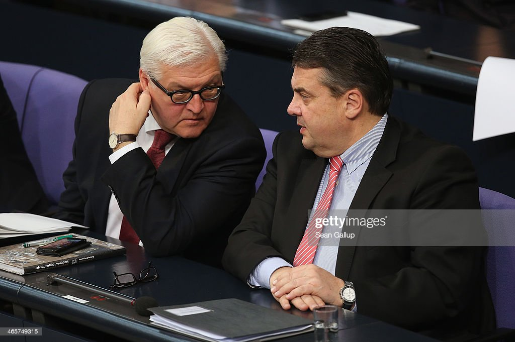 German Foreign Minister <a gi-track='captionPersonalityLinkClicked' href=/galleries/search?phrase=Frank-Walter+Steinmeier&family=editorial&specificpeople=603500 ng-click='$event.stopPropagation()'>Frank-Walter Steinmeier</a> (L) and Vice Chancellor and Economy and Energy Minister <a gi-track='captionPersonalityLinkClicked' href=/galleries/search?phrase=Sigmar+Gabriel&family=editorial&specificpeople=543927 ng-click='$event.stopPropagation()'>Sigmar Gabriel</a> attend debates at the Bundestag following a government declaration given by German Chancellor Angela Merkel, in which she outlined the policy priorities of the new German coalition government of Christian Democrats and Social Democrats, on January 29, 2104 in Berlin, Germany. The new government was sworn in in December and has a strong majority in the Bundestag to push through legislation.