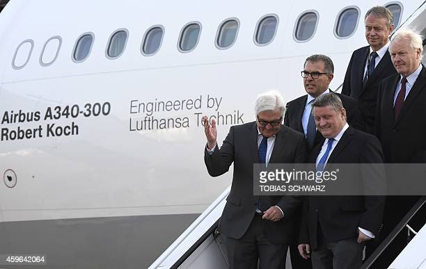 German Foreign Minister FrankWalter Steinmeier chats with German Health Minister Hermann Groehe after visiting the Airbus A340300 plane named Robert...