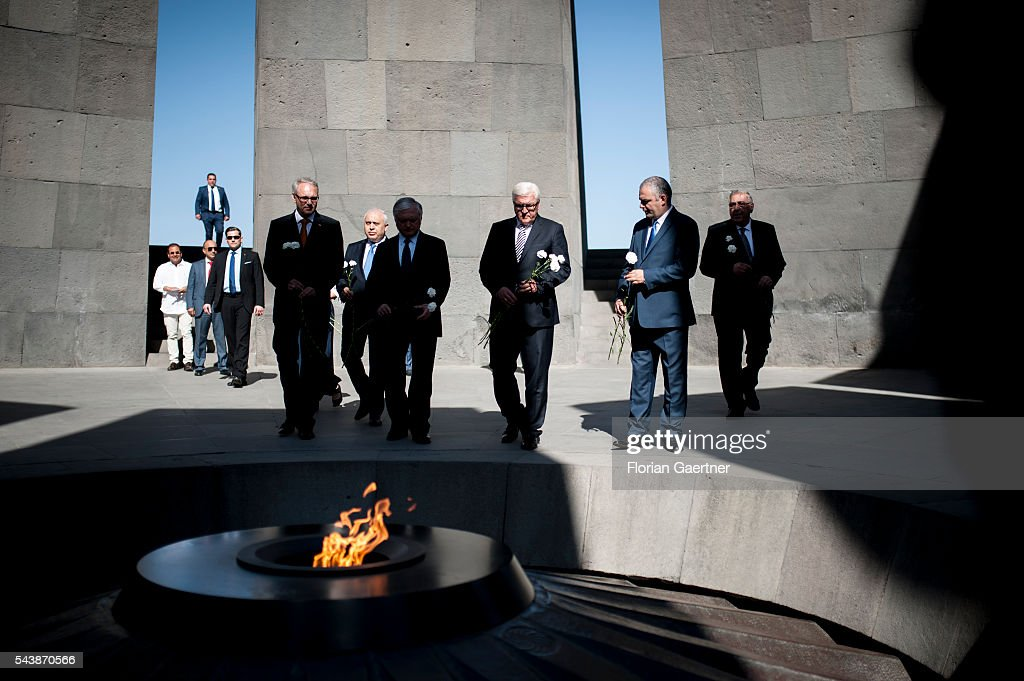 German Foreign Minister Frank-Walter Steinmeier (third from right), Edward Nalbandian (fourth from right), Foreign Minister of Armenia, and the delegation take part in a wreath laying in front of the genocide monument on June 30, 2016 in Yerewan, Armenia. He visits the south caucasian countries Armenia, Azerbaijan and Georgia for political conversations.