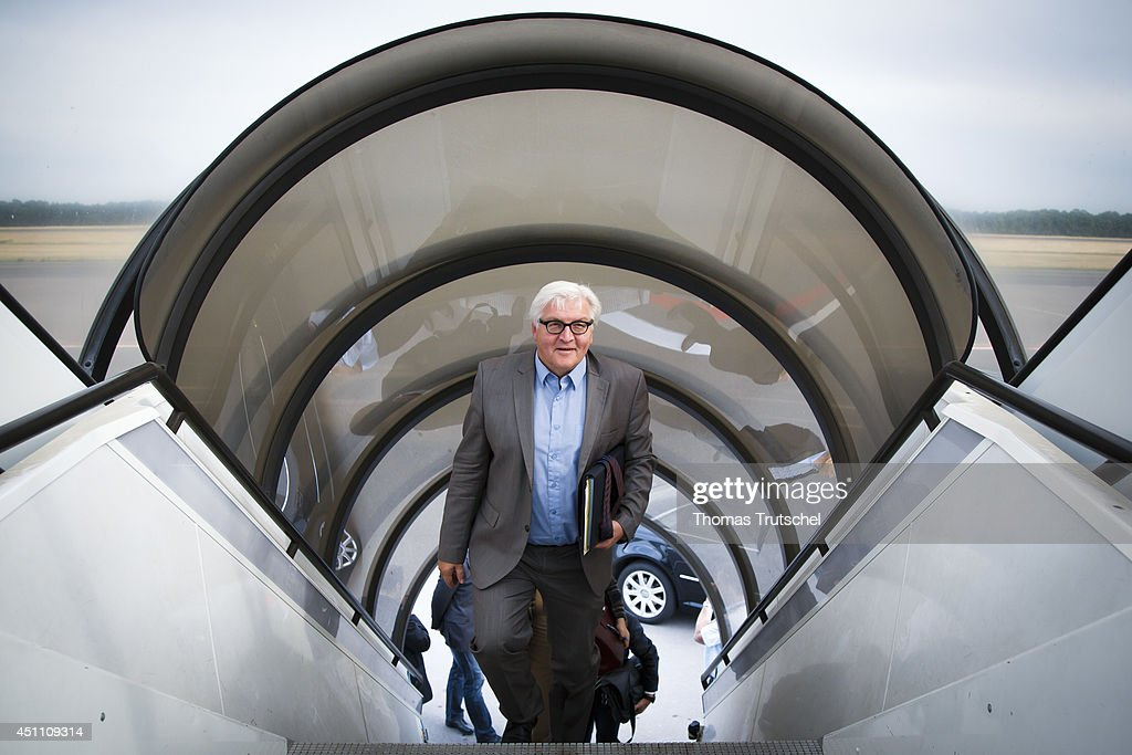 German Foreign Minister FrankWalter Steinmeier enters an airplane of German Airforce at Luxembourg International Airport which brings him to Kiew on...