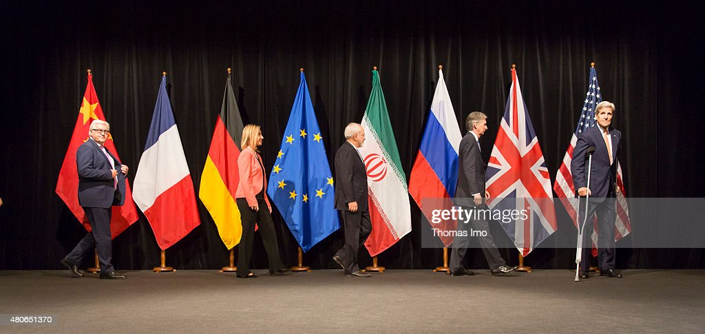 German Foreign Minister Frank-Walter Steinmeier (L-R), EU High Representative for Foreign Affairs and Security Policy Federica Mogherini, Foreign Minister of Iran, Mohammad Javad Zarif, British Foreign Secretary of State for Foreign and Commonwealth Affairs, Philip Hammond, and US Secretary of State John Kerry pose for a photo after last Working Session of E 3+3 negotiations on July 14, 2015 in Vienna, Austria. Six world powers; US, UK, France, China, Russia and Germany have reached a deal with Iran on limiting Iranian nuclear activity.