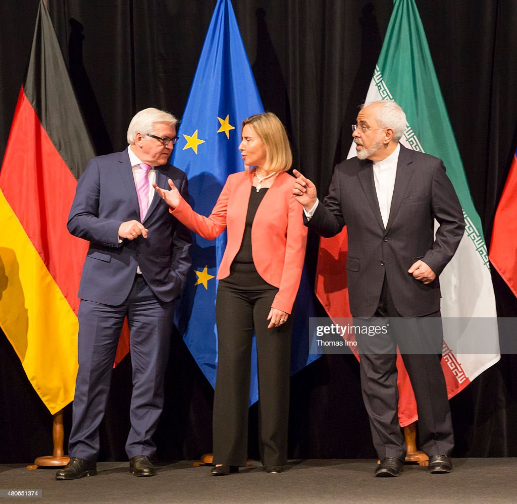 German Foreign Minister Frank-Walter Steinmeier EU High Representative for Foreign Affairs and Security Policy Federica Mogherini, and Foreign Minister of Iran, Mohammad Javad Zarif, (L-R) pose for photo after last Working Session of E 3+3 negotiations on July 14, 2015 in Vienna, Austria. Six world powers; US, UK, France, China, Russia and Germany have reached a deal with Iran on limiting Iranian nuclear activity.