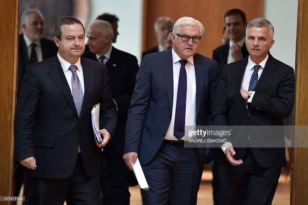 German Foreign Minister <a gi-track='captionPersonalityLinkClicked' href=/galleries/search?phrase=Frank-Walter+Steinmeier&family=editorial&specificpeople=603500 ng-click='$event.stopPropagation()'>Frank-Walter Steinmeier</a> (C) flanked by his Swiss counterpart <a gi-track='captionPersonalityLinkClicked' href=/galleries/search?phrase=Didier+Burkhalter&family=editorial&specificpeople=6269147 ng-click='$event.stopPropagation()'>Didier Burkhalter</a> (R) and Serbian counterpart and OSCE Chairperson <a gi-track='captionPersonalityLinkClicked' href=/galleries/search?phrase=Ivica+Dacic&family=editorial&specificpeople=5427949 ng-click='$event.stopPropagation()'>Ivica Dacic</a> (L) arrive for a joint press conference after their meeting in Belgrade on April 28, 2015.