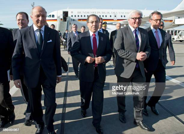 German Foreign Minister FrankWalter Steinmeier French Foreign Minister Laurent Fabius and Tunisian Foreign Minister Monghi Hamdiam meet on the...