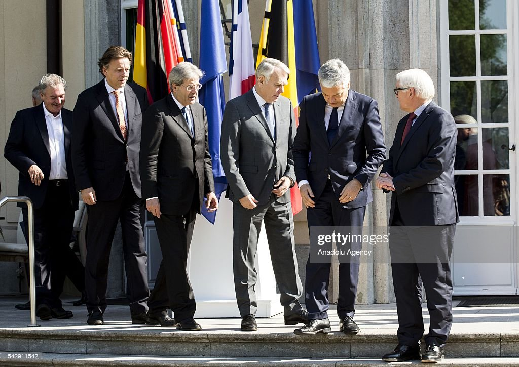 German Foreign Minister Frank-Walter Steinmeier (R), French Foreign Minister Jean-Marc Ayrault (R-3), Dutch Foreign Minister Bert Koenders (R-2), Italian Foreign Minister Paolo Gentiloni (L-3), Belgian Foreign Minister Didier Reynders (R-2) and Luxembourgs Foreign Minister Jean Asselborn (L) pose for a photograph before their meeting to discuss United Kingdom's decision on leaving European Union (EU), at German foreign ministry's guest house Villa Borsig in Berlin, Germany on June 25, 2016.