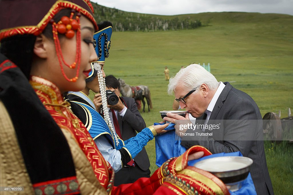 German Foreign Minister FrankWalter Steinmeier gets a welcome bowl of mare's milk at the Entrance of Chinggis Khuree Camp on July 06 2014 in...