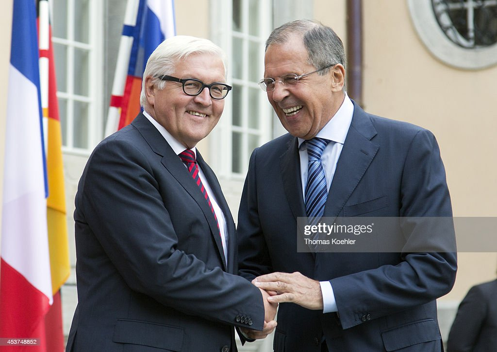 German Foreign Minister <a gi-track='captionPersonalityLinkClicked' href=/galleries/search?phrase=Frank-Walter+Steinmeier&family=editorial&specificpeople=603500 ng-click='$event.stopPropagation()'>Frank-Walter Steinmeier</a> (L) greets Russian Foreign Minister Sergey Lavrov prior to talks with French Foreign Minister Laurent Fabius, Ukrainian Foreign Minister Pavlo Klimkin to discuss the ongoing conflict in eastern Ukraine at Villa Borsig on August 17, 2014 in Berlin, Germany. The four men are meeting following the one confirmed incursion by military vehicles from Russian soil into Ukraine and the statement by a separatist leader that Russia had supplied them with heavy tanks, training and personnel, which has heightened tension and increased fears of a possible imminent Russian invasion.