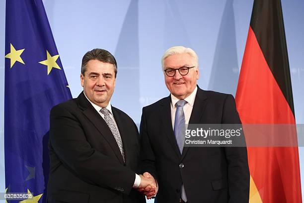 German Foreign Minister FrankWalter Steinmeier hands over his office to his successor Sigmar Gabriel at the Ministry of Foreign Affairs on January 27...