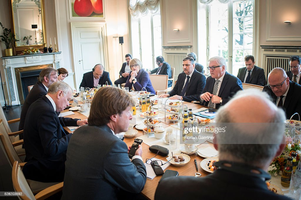 German Foreign Minister Frank-Walter Steinmeier (second from right), Jean-Marc Ayrault (L), Minister for Foreign Affairs of France and the Riad Hijab, chief coordinator for Syria's opposition High Negotiations Committee (HNC) (thrid from right) get together on May 04, 2016 in Berlin, Germany. The meeting was held to discuss Syria as concerns grow over the faltering ceasefire in the war-torn country.