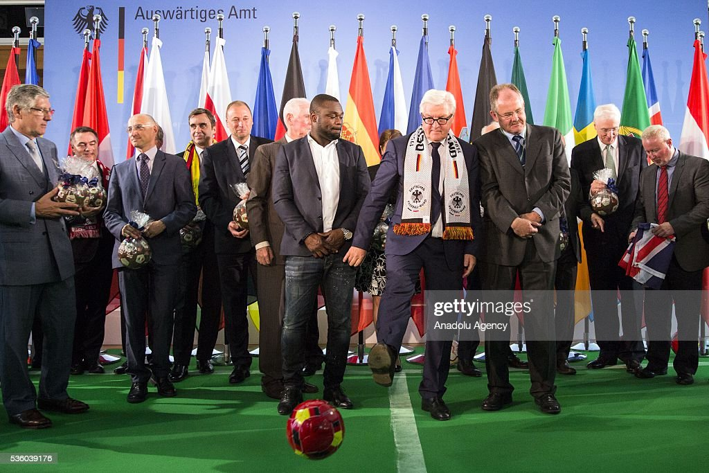 German Foreign Minister Frank-Walter Steinmeier kicks a ball during a ceremony at the foreign ministry in Berlin on May 31, 2016, ahead of the UEFA Euro 2016 taking place in France next month.