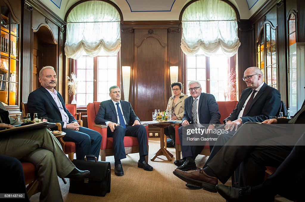 German Foreign Minister Frank-Walter Steinmeier (2ndR) meets the syrian representative of the opposition Riad Hijab (L) on May 04, 2016 in Berlin, Germany. They get together for conversations about the civil war in Syria.