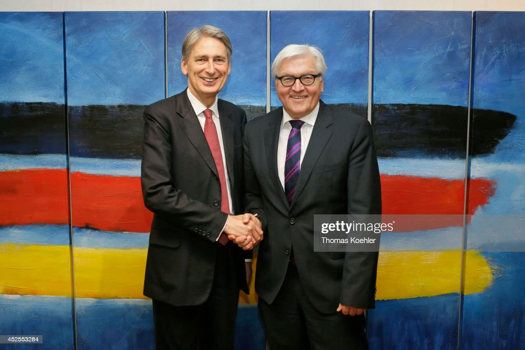 German Foreign Minister Frank-Walter Steinmeier (R) meets with British Foreign Affairs Minister Philip Hammond on July 23, 2014 during a meeting of EU-ASEAN Foreign Ministers in Brussels, Belgium.