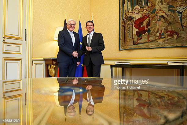 German Foreign Minister FrankWalter Steinmeier meets with French Prime Minister Manuel Valls on October 02 2014 in Paris France Steinmeier is on a...