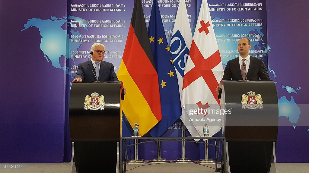 German Foreign Minister Frank-Walter Steinmeier (L) meets with Georgian Prime Minister Dimitri Kumsiashvili (R) in Tbilisi, Georgia on July 1, 2016.