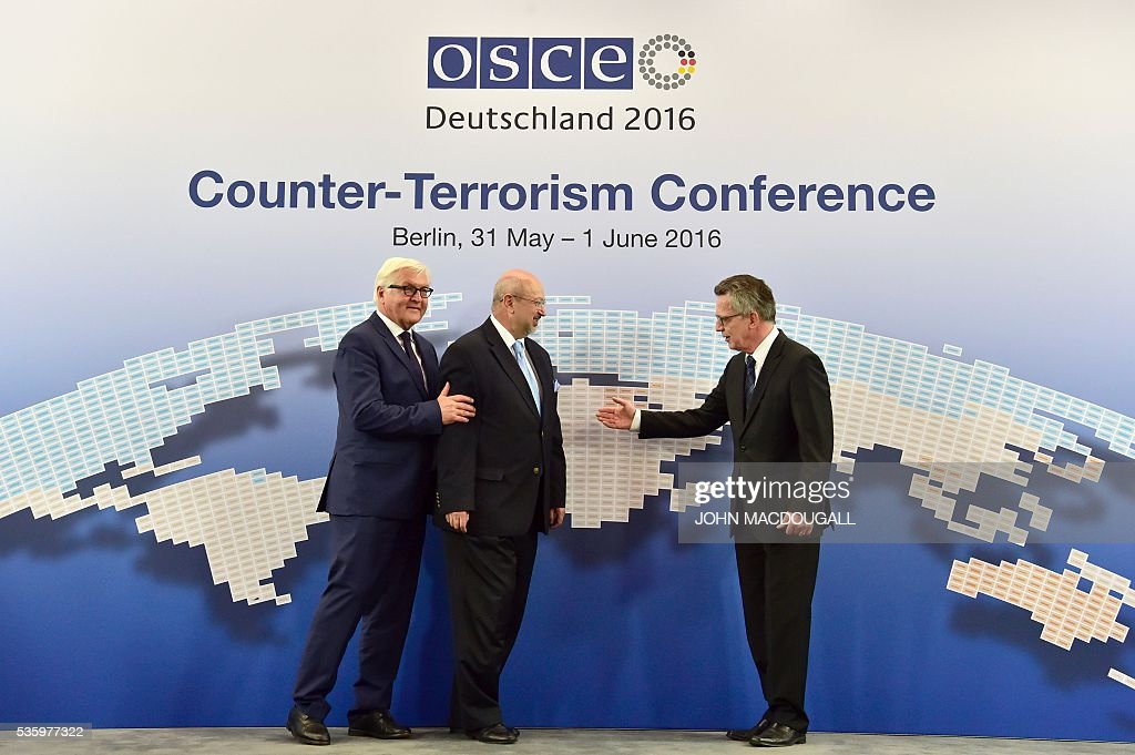 German Foreign Minister Frank-Walter Steinmeier, OSCE Secretary General Lamberto Zannier, and German Interior Minister Thomas de Maiziere pose for photographers prior to the opening day of the two-day Counter-Terrorism Conference of the Organisation for Security and Cooperation in Europe (OSCE) at the foreign ministry in Berlin on May 31, 2016. / AFP / John MACDOUGALL