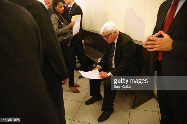 German Foreign Minister FrankWalter Steinmeier pauses to read a document before speaking to the media after he attended the graduation of rabbinical...