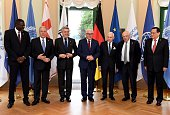 German Foreign Minister FrankWalter Steinmeier poses with the Secretary General of the International Federation of Red Cross and Red Crescent...