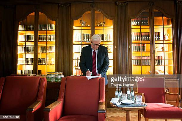 German Foreign Minister FrankWalter Steinmeier prepares himself to discuss the ongoing conflict in eastern Ukraine at Villa Borsig with the foreign...