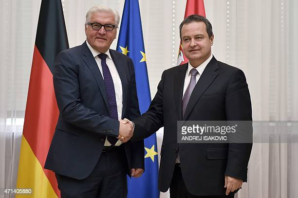 German Foreign Minister FrankWalter Steinmeier shakes hands with his Serbian counterpart and OSCE Chairperson Ivica Dacic prior their meeting in...