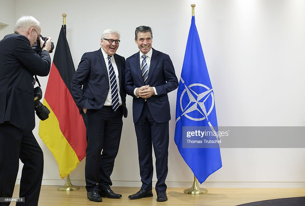 German Foreign Minister <a gi-track='captionPersonalityLinkClicked' href=/galleries/search?phrase=Frank-Walter+Steinmeier&family=editorial&specificpeople=603500 ng-click='$event.stopPropagation()'>Frank-Walter Steinmeier</a> (L) shakes hands with Secretary-General of The North Atlantic Treaty Organization ( NATO ) <a gi-track='captionPersonalityLinkClicked' href=/galleries/search?phrase=Anders+Fogh+Rasmussen&family=editorial&specificpeople=549374 ng-click='$event.stopPropagation()'>Anders Fogh Rasmussen</a> on January 20, 2014 in Brussels, Belgium. Steinmeier is on a one day trip to Brussels.