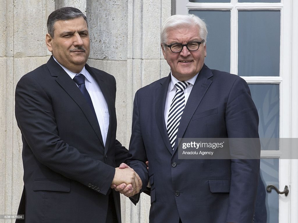 German Foreign Minister Frank-Walter Steinmeier (R) shakes hands with the Former Syrian Prime Minister Riyad Farid Hijab at the German Foreign Ministry's guest house Villa Borsig in Berlin, Germany on May 4, 2016.