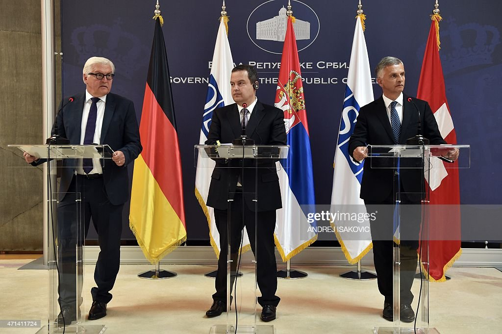 German Foreign Minister <a gi-track='captionPersonalityLinkClicked' href=/galleries/search?phrase=Frank-Walter+Steinmeier&family=editorial&specificpeople=603500 ng-click='$event.stopPropagation()'>Frank-Walter Steinmeier</a> (L) speaks during a joint press conference with his Swiss counterpart <a gi-track='captionPersonalityLinkClicked' href=/galleries/search?phrase=Didier+Burkhalter&family=editorial&specificpeople=6269147 ng-click='$event.stopPropagation()'>Didier Burkhalter</a> (R) and Serbian counterpart and OSCE Chairperson <a gi-track='captionPersonalityLinkClicked' href=/galleries/search?phrase=Ivica+Dacic&family=editorial&specificpeople=5427949 ng-click='$event.stopPropagation()'>Ivica Dacic</a> (C) after their meeting in Belgrade on April 28, 2015.