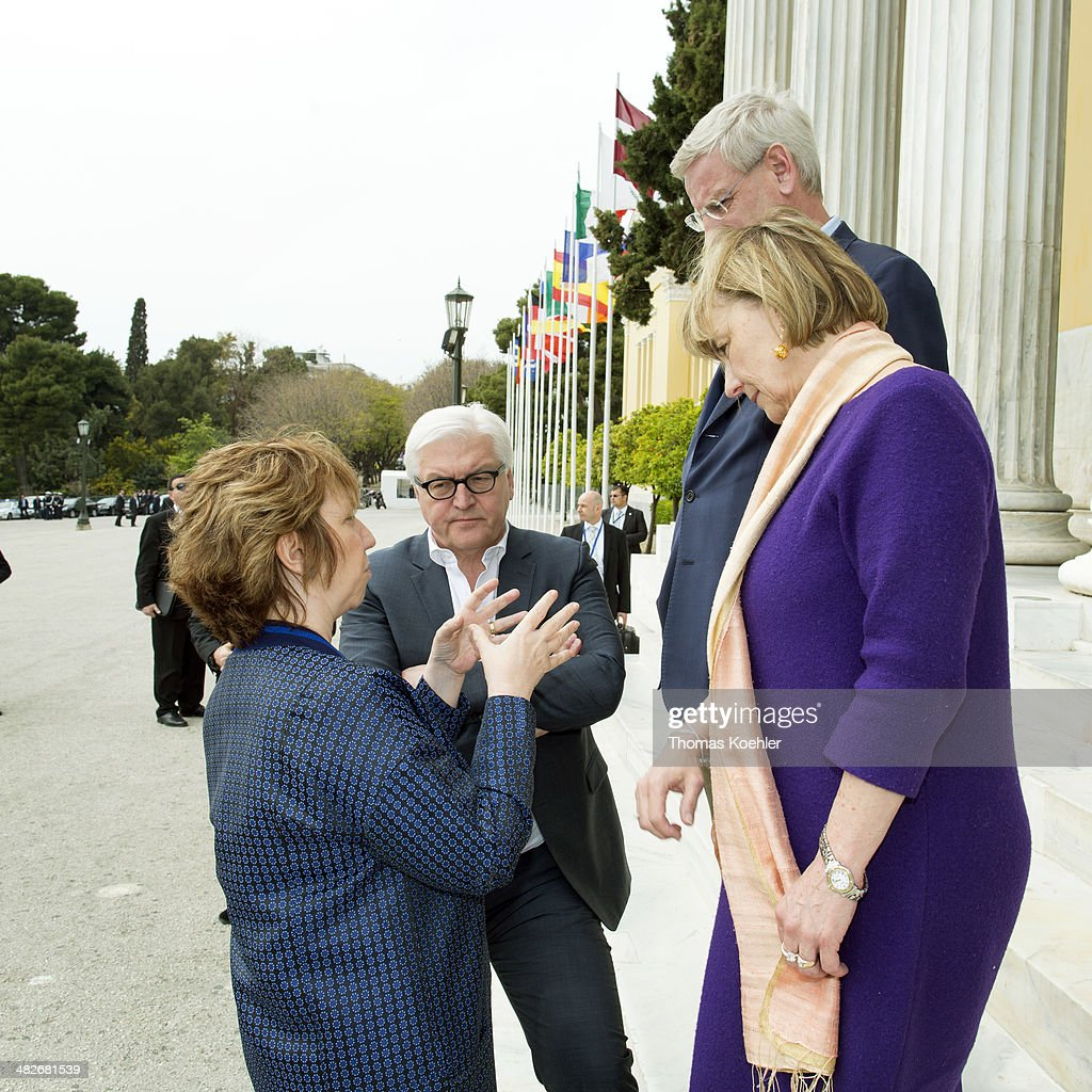 German Foreign Minister <a gi-track='captionPersonalityLinkClicked' href=/galleries/search?phrase=Frank-Walter+Steinmeier&family=editorial&specificpeople=603500 ng-click='$event.stopPropagation()'>Frank-Walter Steinmeier</a> speaks with Vice President of the European Commission and High Representative of the Union for Foreign Affairs and security policy <a gi-track='captionPersonalityLinkClicked' href=/galleries/search?phrase=Catherine+Ashton&family=editorial&specificpeople=2314228 ng-click='$event.stopPropagation()'>Catherine Ashton</a> (L), Sweden's Foreign Minister <a gi-track='captionPersonalityLinkClicked' href=/galleries/search?phrase=Carl+Bildt&family=editorial&specificpeople=3972090 ng-click='$event.stopPropagation()'>Carl Bildt</a> (R) and Italian's Foreign Minister Federica Mogherini while an Informal Meeting of EU Foreign Affairs Ministers (Gymnich) at the Zappeion Hall on April 04, 2014 in Athens, Greece.