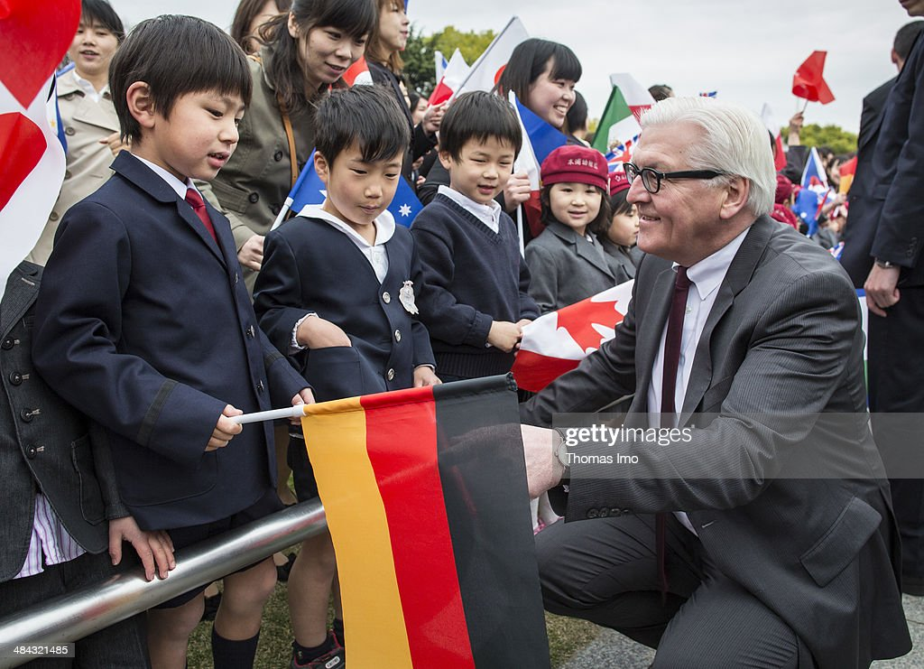 German Foreign Minister <a gi-track='captionPersonalityLinkClicked' href=/galleries/search?phrase=Frank-Walter+Steinmeier&family=editorial&specificpeople=603500 ng-click='$event.stopPropagation()'>Frank-Walter Steinmeier</a> talks to children during his visit to the monument for the 1945 atomic bomb victims at the Hiroshima Peace Memorial Park on April 12, 2014 in Japan. Steinmeier is on a two day visit to Japan, during which he will attend the 8th Non-Proliferation and Disarmament Initiative (NPDI) Ministerial Meeting with other Foreign ministers .